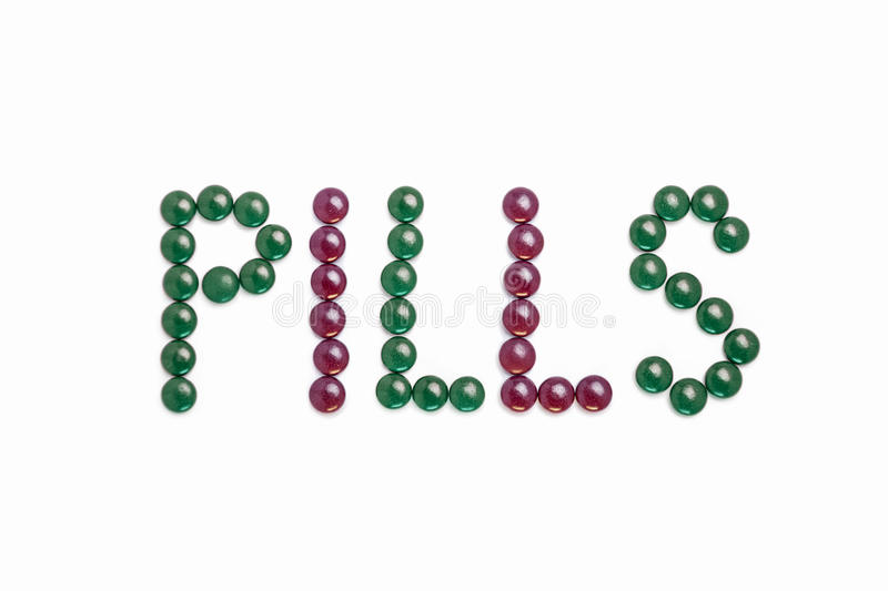 Pills written with green and purple pills royalty free illustration