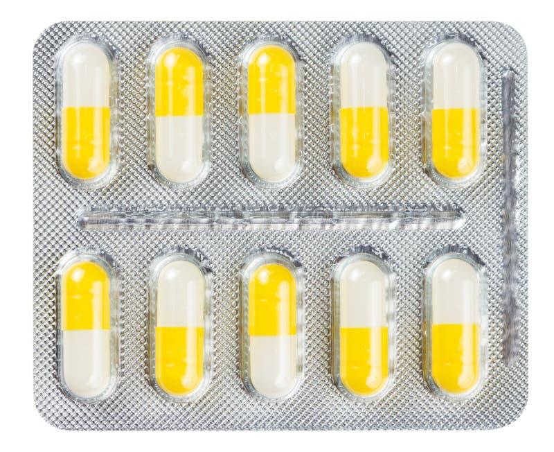 Pillules dans un emballage transparent image stock