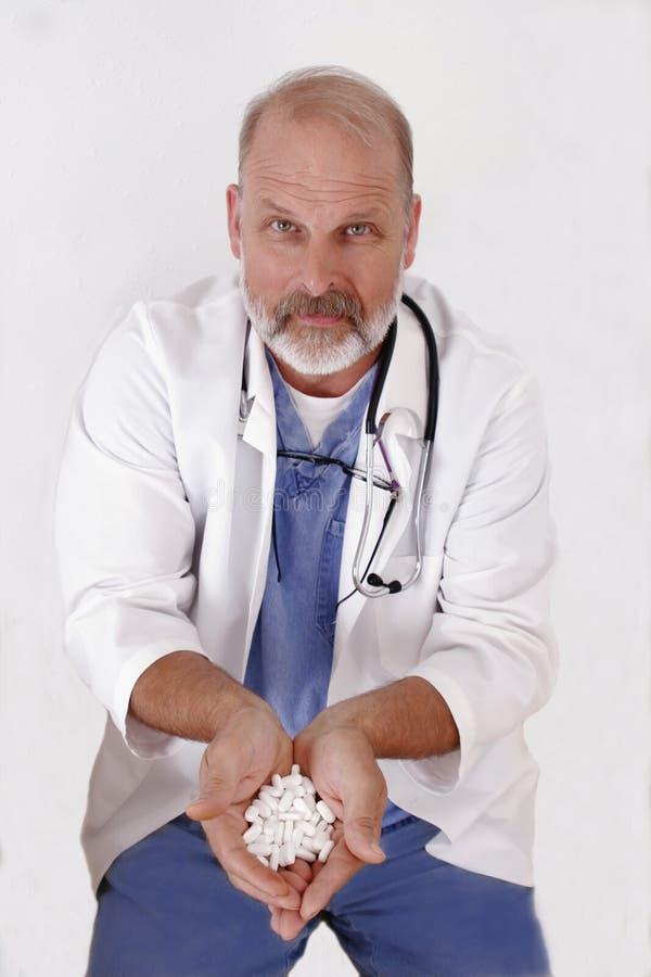 Pillules de offre de docteur image libre de droits