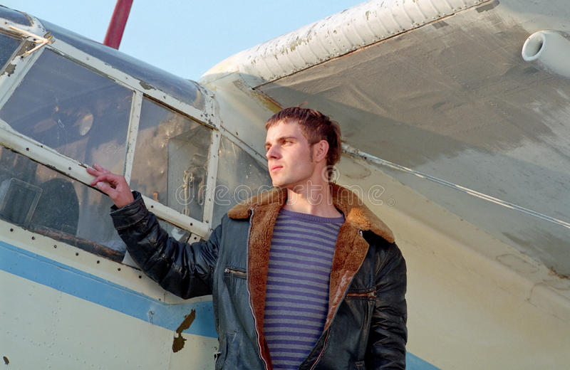 Pilot before aeroplane. Strong pilot before a aeroplane royalty free stock photography
