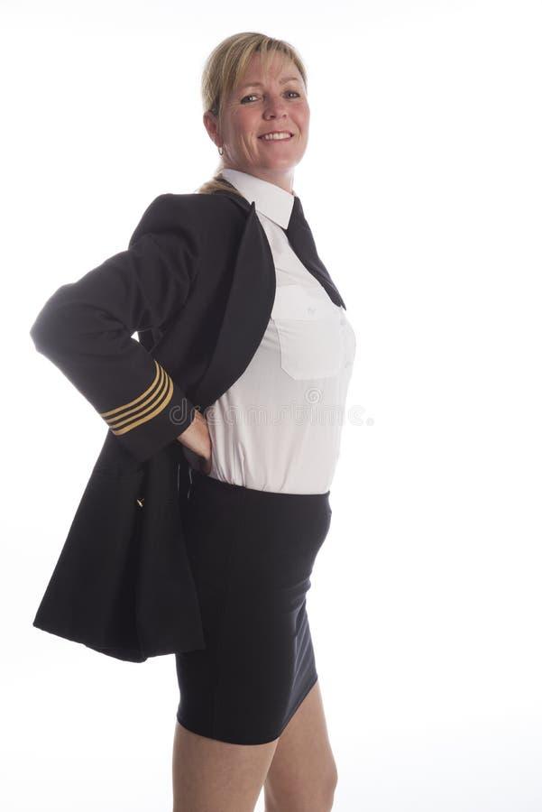 Pilot- anseende för flygbolag som justerar hennes likformig arkivfoton