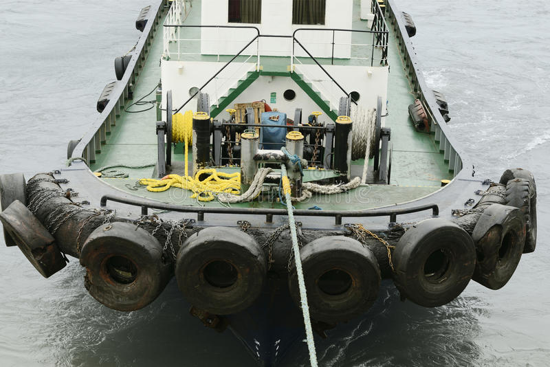 Pilot boat attached to large ship stock photo