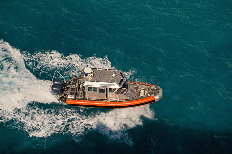 Pilot Boat on blue water stock photos