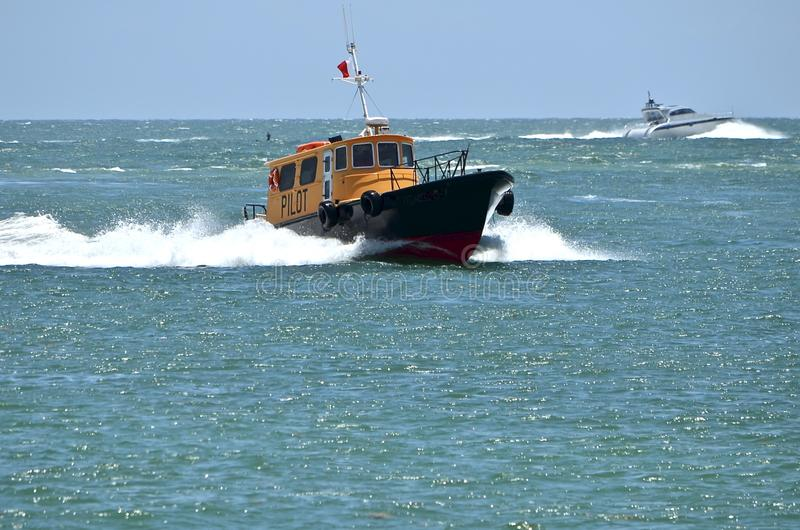 Pilot Boat Returning to Home Port. Miami,Florida based pilot boat returning home after guiding a ship out of Port Miami stock image