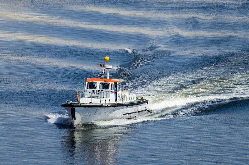 Pilot boat travelling at speed stock images