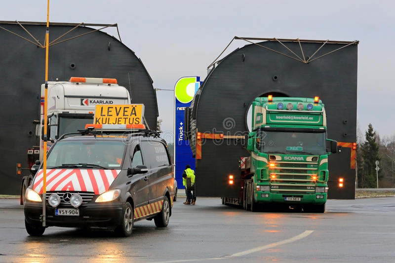 Pilot Car And Two Trucks With Oversize Loads Editorial