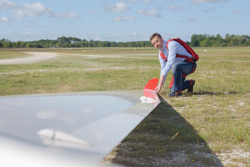Pilot checking glider just before taking off stock images