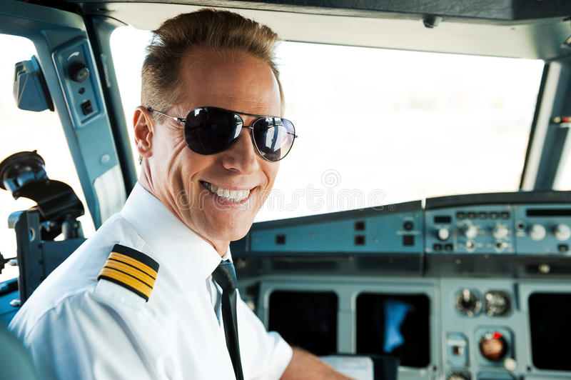Pilot in cockpit. stock photography