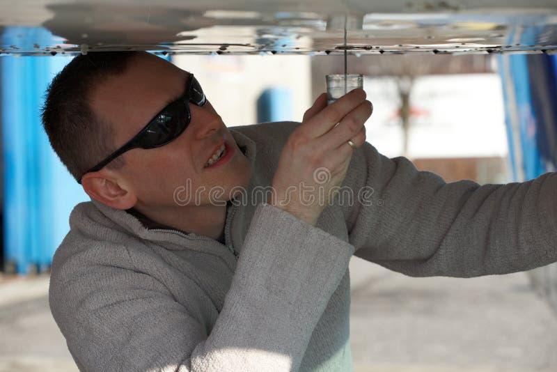 Pilot doing pre-flight checking stock photos