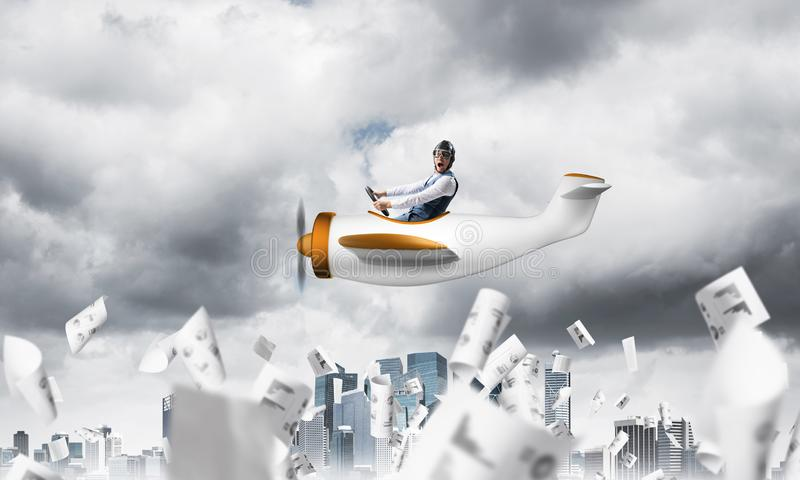 Pilot flying in small paper airplane. Crisis management and control in difficult situation concept. Businessman in aviator hat driving propeller plane in storm royalty free illustration