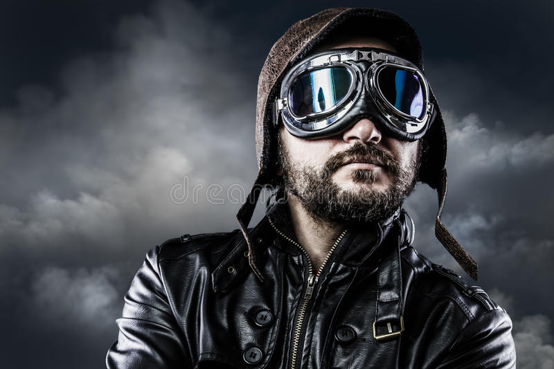 Pilot with glasses and vintage hat with proud expression. War stock photography