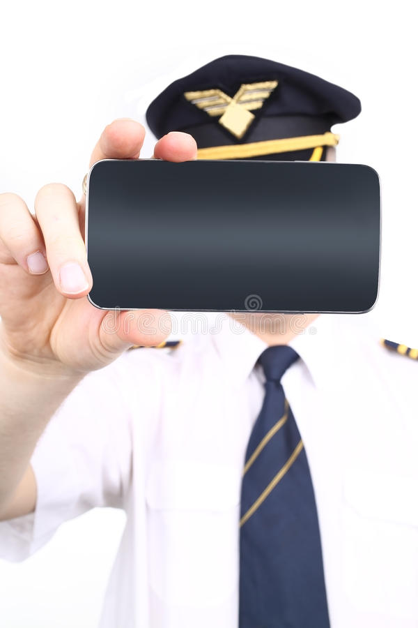 Pilot holding a phone stock photo