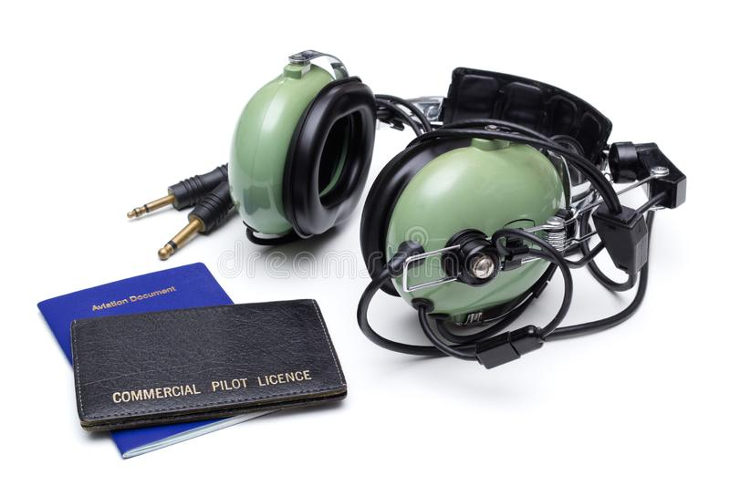Pilot License And Headset. Commercial pilot license and headset on white royalty free stock photos