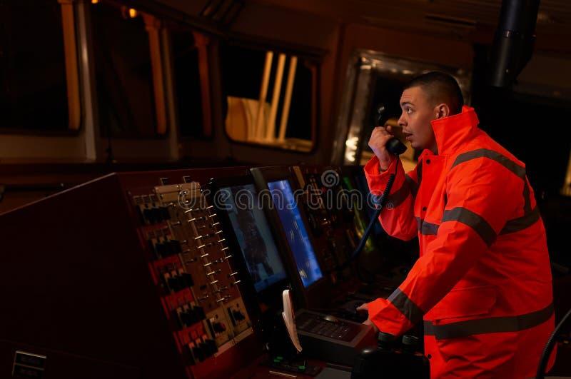 Pilot / Navigator on the ship`s bridge royalty free stock image