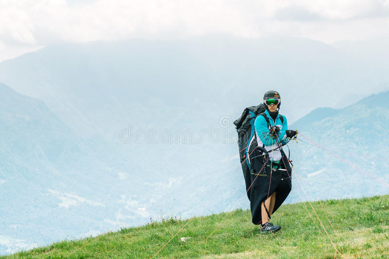 Pilot of paragliding preparing to take off royalty free stock photography