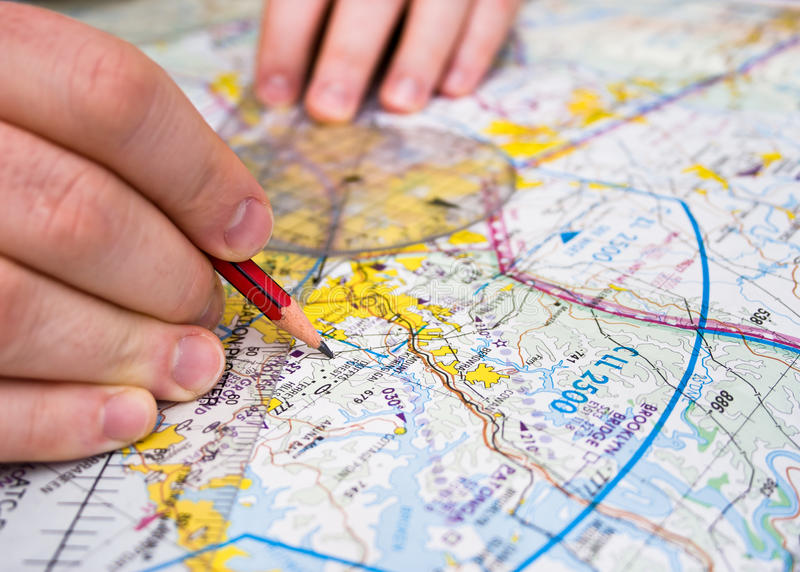 Pilot plotting a course on a map royalty free stock images