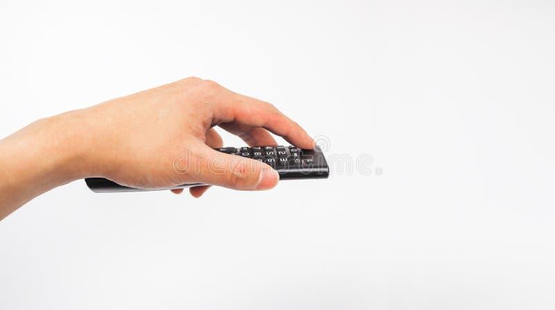 Pilot tv w ręki mieniu, zmiana kanały zdjęcia royalty free
