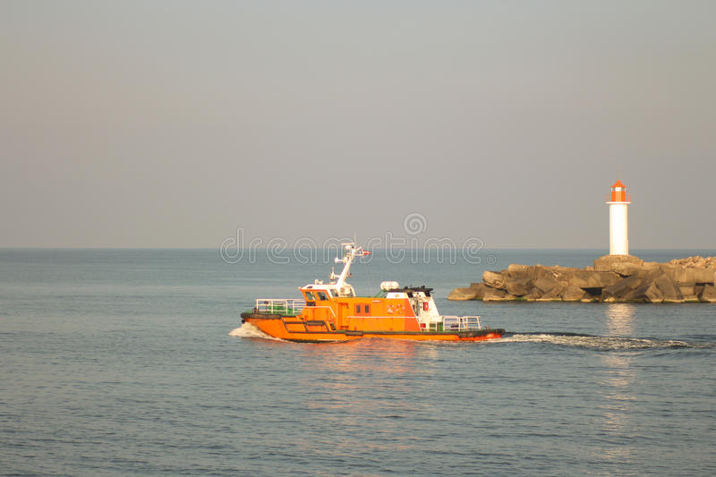 Pilot vessel leaving the port of Ventspils.  royalty free stock photos