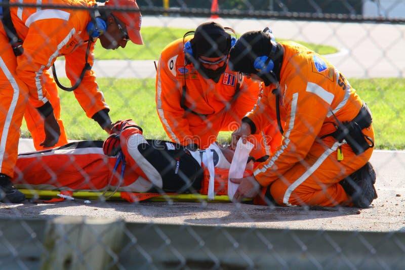 Pilote de course blessé image stock