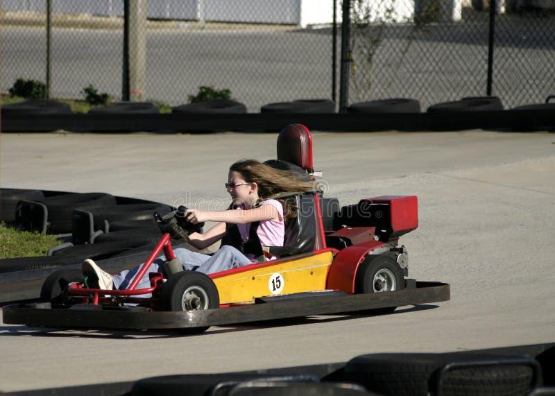 Piloter de fille vont chariot photo stock