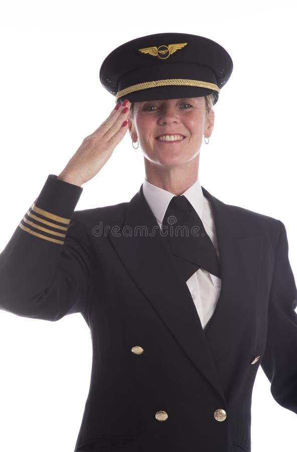 Piloto De La Línea Aérea Que Lleva Saludar Uniforme Del Sombrero ...