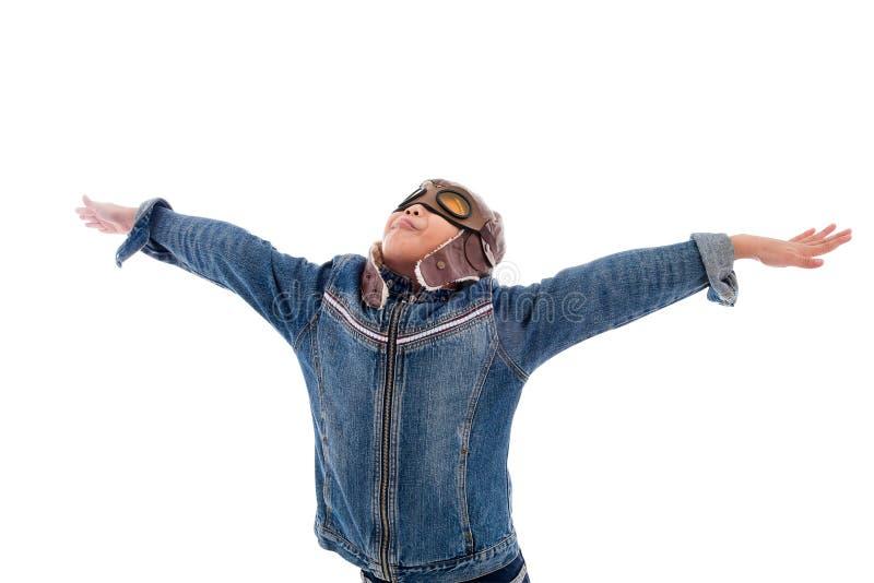 Piloto joven del muchacho aislado en blanco fotografía de archivo libre de regalías