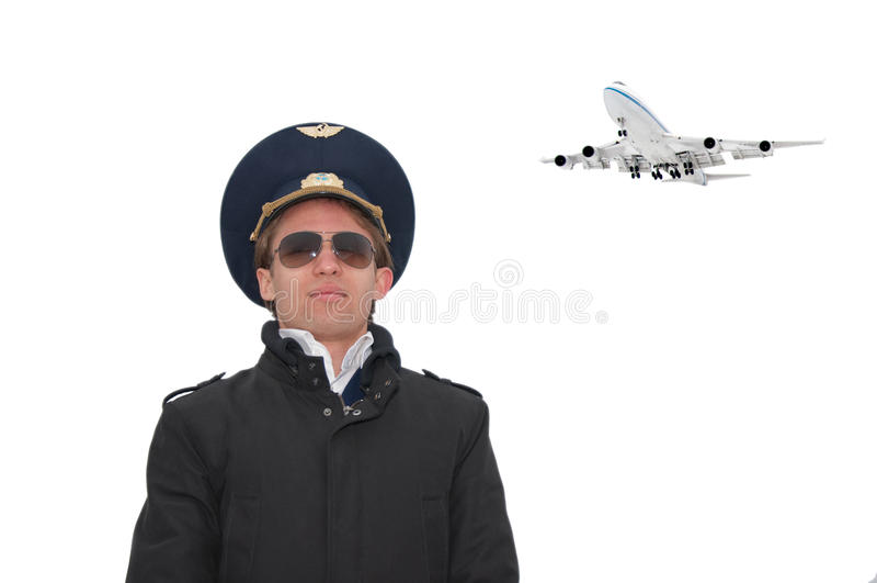 Piloto joven en los vidrios aislados con el copyspace foto de archivo libre de regalías