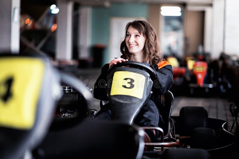Piloto karting da moça fotografia de stock royalty free