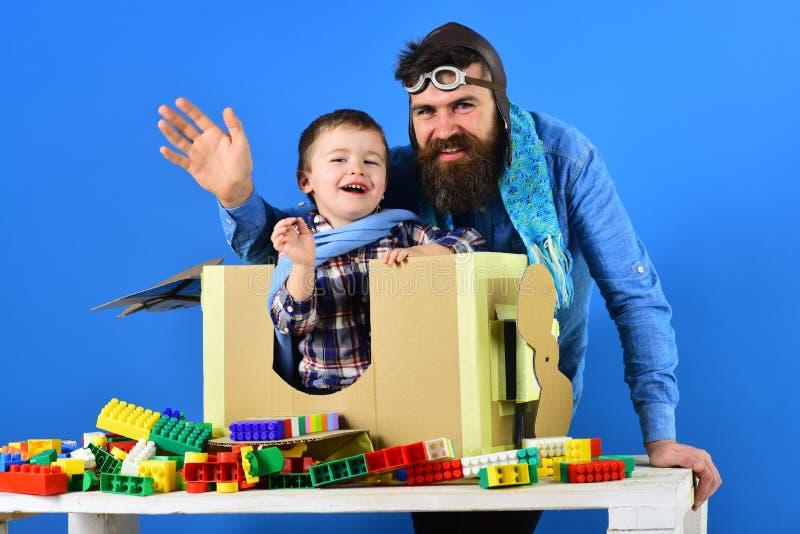 Pilotos Pai e filho jogam aviação Transporte aéreo Voo com crianças fotografia de stock