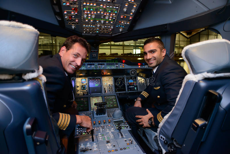 Pilots in Emirates Airbus A380 aircraft after landing royalty free stock photos