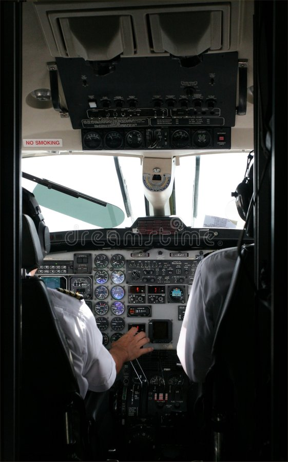 Download Pilots and Flight Deck stock image. Image of flight, land - 177513