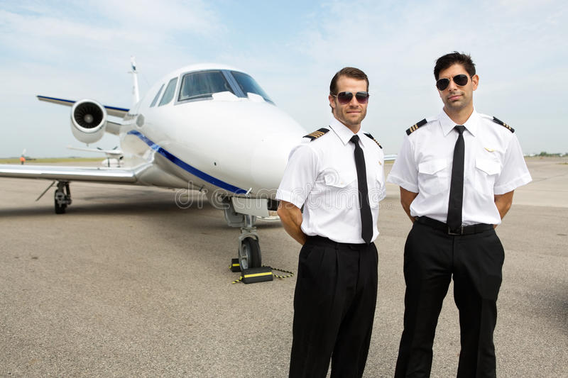 Download Pilots Standing In Front Of Private Jet Stock Photo - Image: 36488668