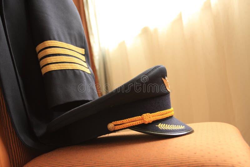 Pilots uniform. Captain pilot have much responsibility for flight safty, it's captain's stately uniform stock photos