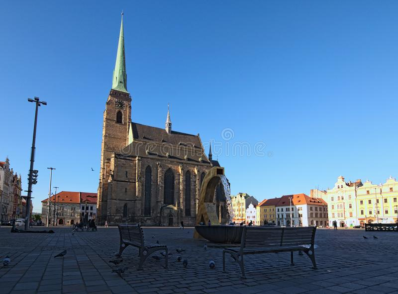 Ancient Cathedral of St. Bartholomew at square of Republic in Pilsen Plzen. Fountain in the foreground stock image