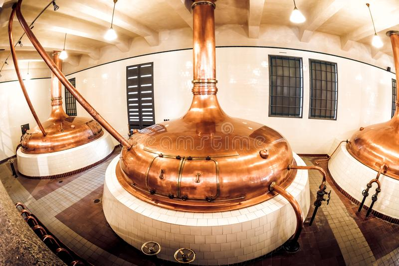 PILSEN PLZEN, CZECH REPUBLIC - MAY 22, 2017: Copper distillery. Tanks in old brewery in Pilsner Urquell Brewery royalty free stock image