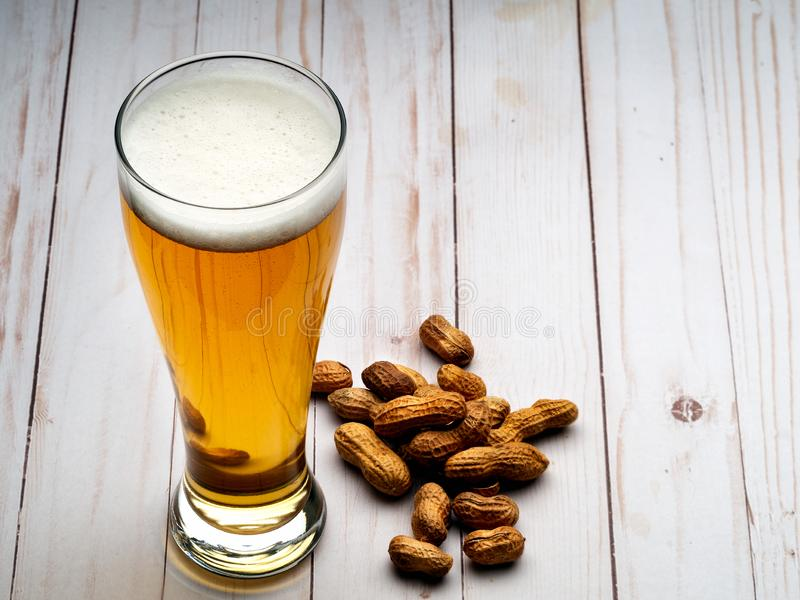 Pilsner beer and peanuts stock photos