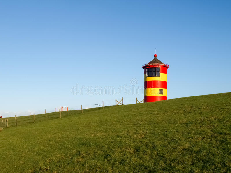 Pilsum, lighthouse at North sea of Germany. royalty free stock image