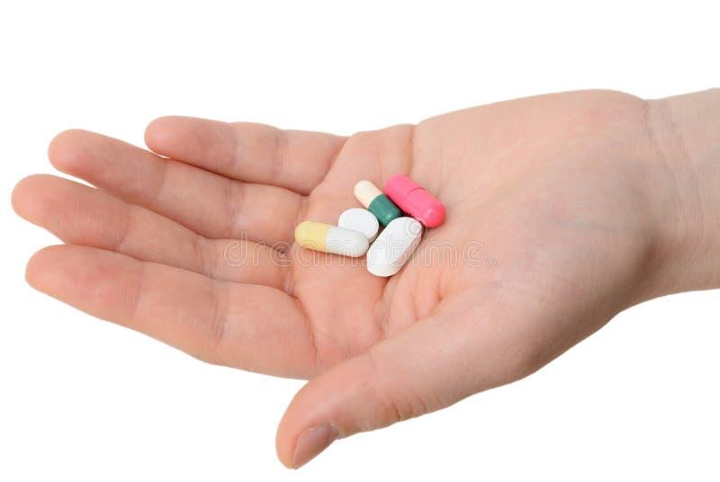 Pilules en main photographie stock