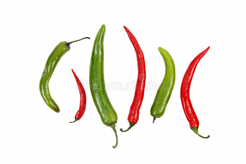 Pimentas agradáveis frescas vermelhas e verdes - muito quentes! fotografia de stock