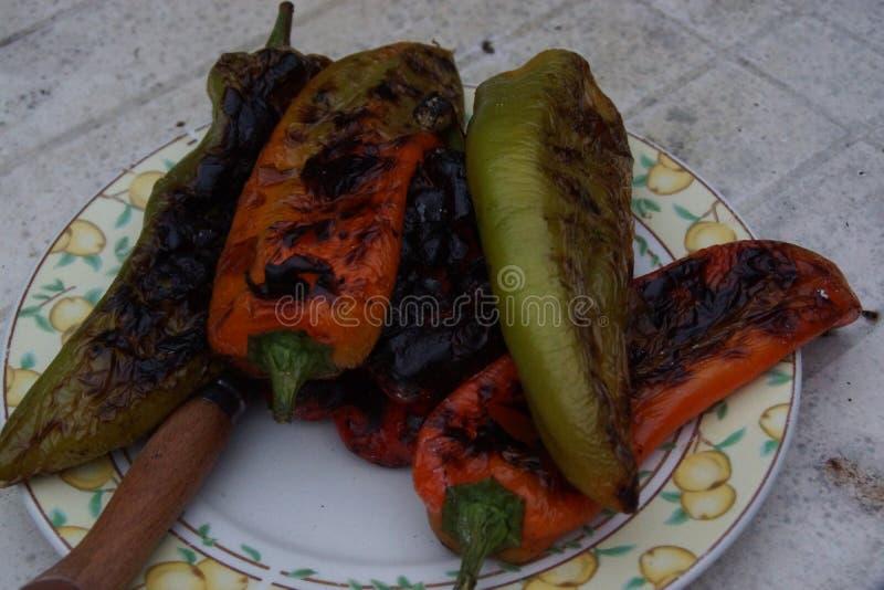 Pimentas doces cozinhadas com o assado imagens de stock