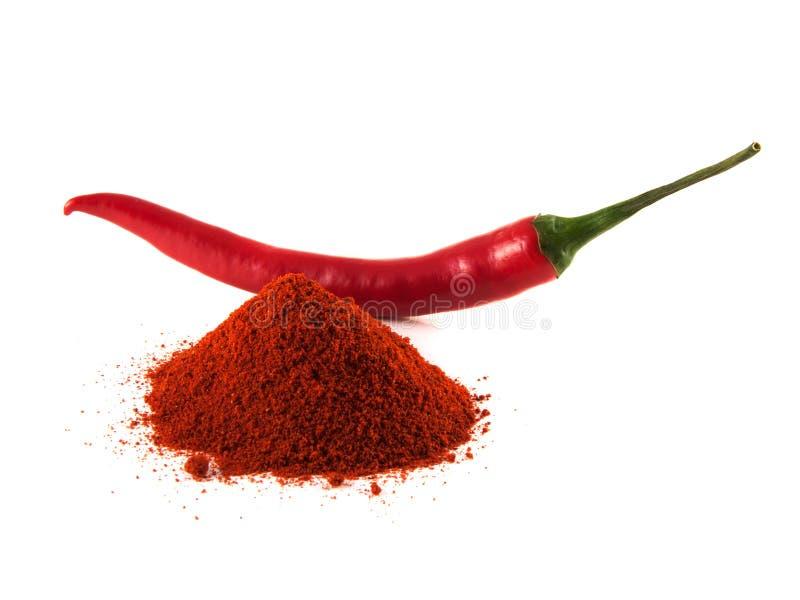 Pimento de pimentão vermelho com o monte da paprika doce fotos de stock