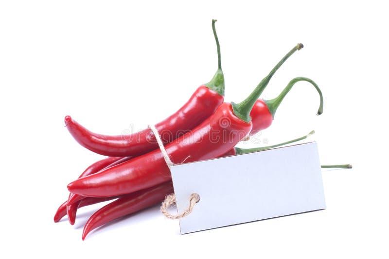 Pimienta de chile rojo con la etiqueta foto de archivo
