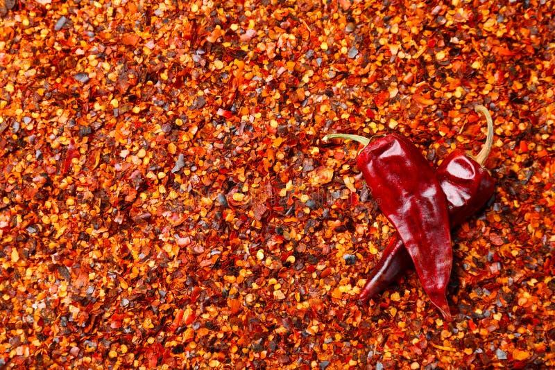 Pimienta y vainas machacadas de chile imagenes de archivo