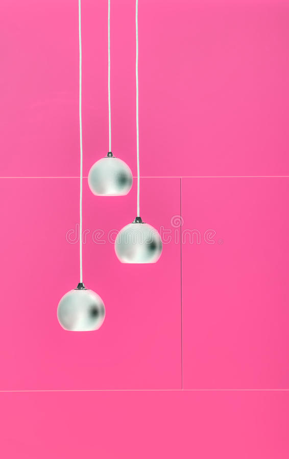 Pimk negative collage of three ceiling lights stock photo