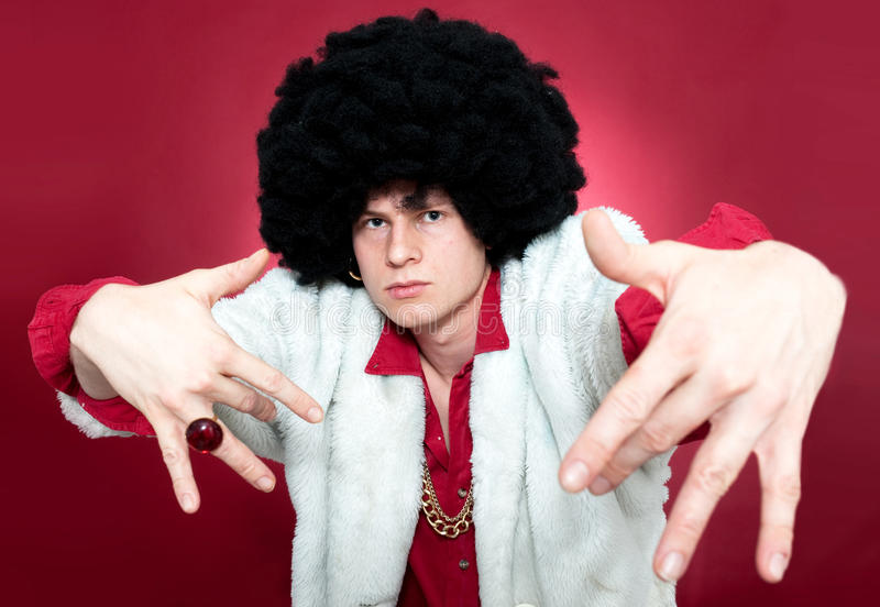 Pimp. Arrogantly looking man, wearing a wig and a golden chain stock images