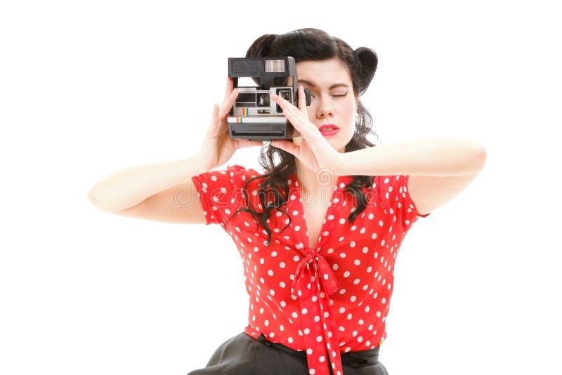 Pin女孩美国风格的减速火箭的妇女照相机 免版税库存图片