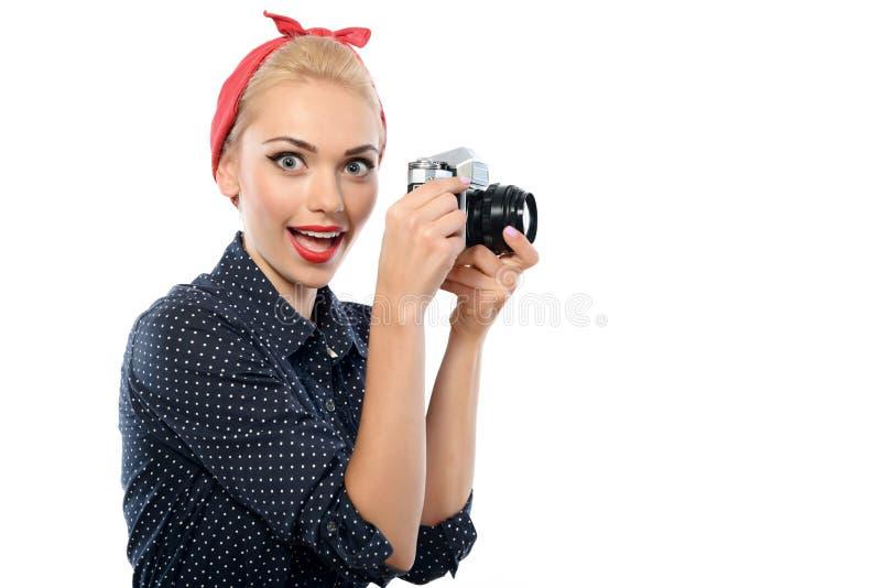 Pin acima da menina com uma câmera imagem de stock