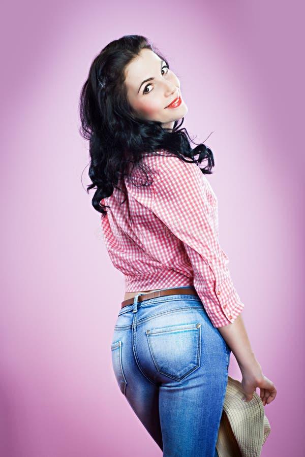 Pin acima da menina na calças de ganga imagem de stock royalty free