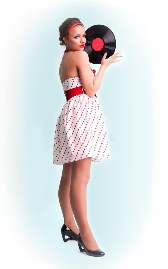 Pin acima da mulher com registro de vinil fotografia de stock