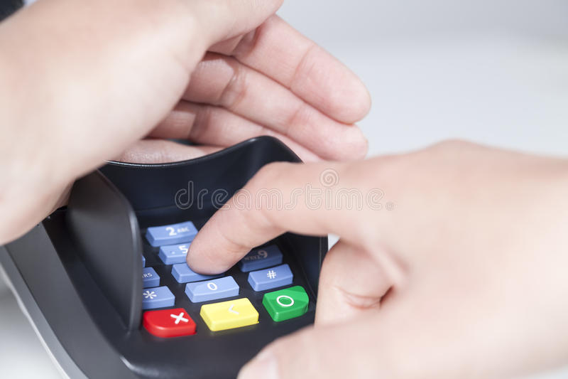 Pin Code in card reader. Entering a PIN Code in a card reader (payment royalty free stock photos